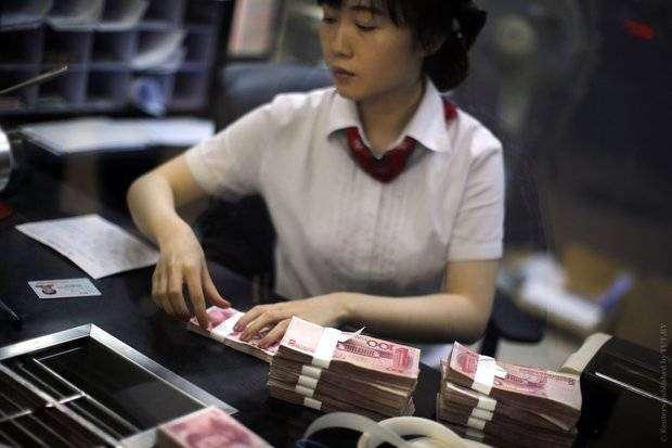 Китай девальвировал юань на максимальную за 20 лет величину