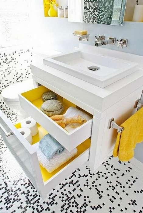 Вместительный шкафчик с выдвижными ящиками можно разместить в пространстве под мойкой.
