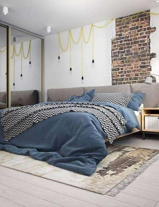 Комбинированное оформление стен подчеркивает особенности промышленного дизайна и оставляет яркие впечатления о нем.
