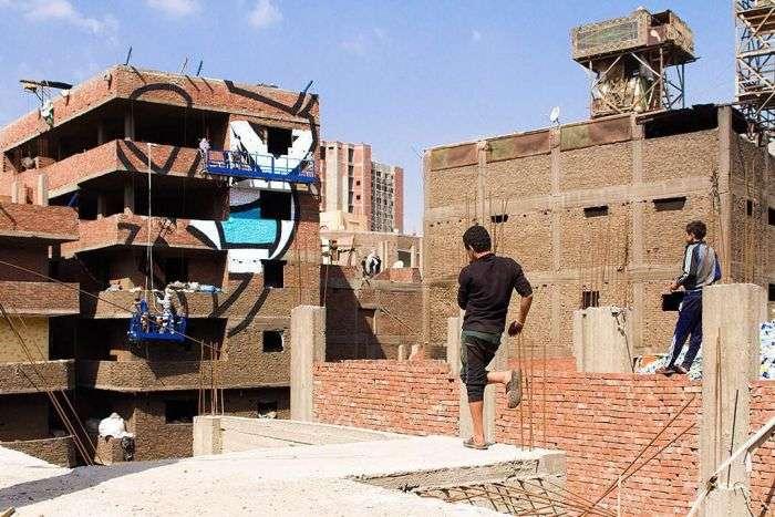 На стенах 50 домов Каира появился гигантский граффити-пазл (6 фото)