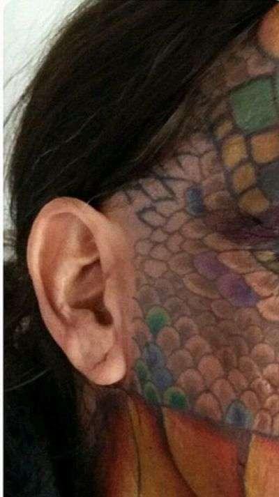 55-летний трансгендер превратил себя в дракона (14 фото)