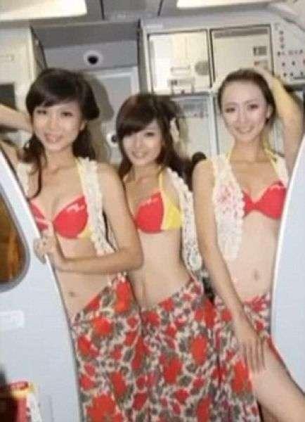 Вьетнамские авиалинии сняли со стюардесс все, кроме бикини (11 фото)