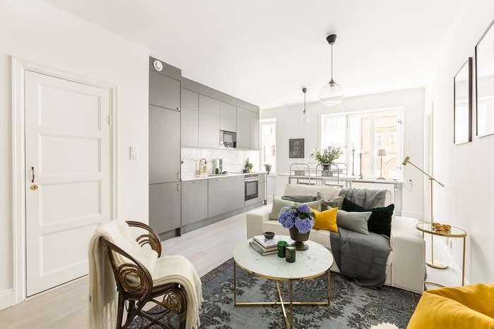 Кухня в квартире-студии: 5 реальных примеров того, как можно зонировать пространство