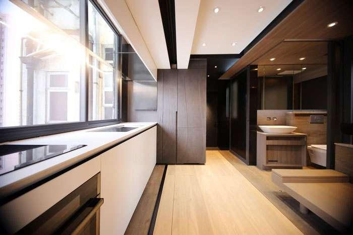 Как уместить полноценную кухню, ванную, домашний кинотеатр и спальню для гостей на 28 кв. метрах (16 фото)