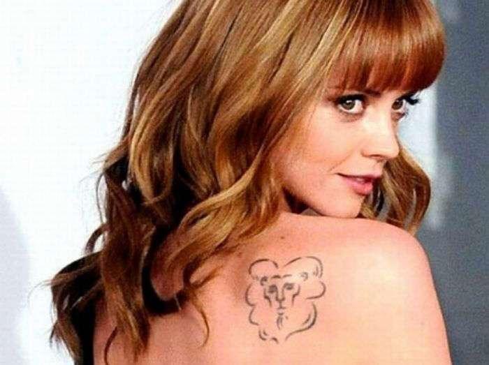 Татуировки, украшающие тела знаменитостей (42 фото)