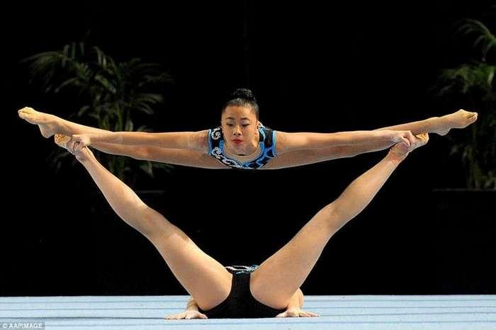 Красота гибкости и силы: фото с чемпионата по гимнастике (12 фото)