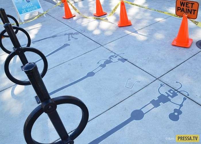 Игры с тенью: художник оживляет скучные улицы с помощью рисунков! (10 фото)