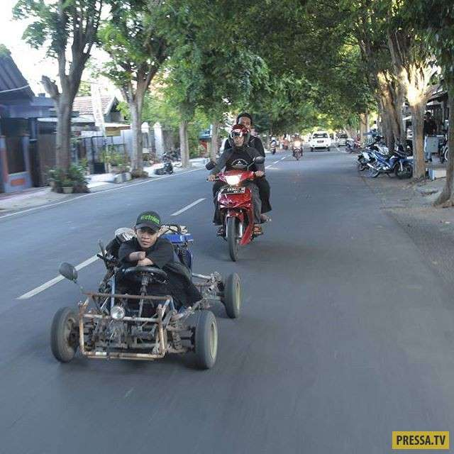 Этот фотограф родился без рук и ног, но это не мешает ему заниматься любимым делом (25 фото)